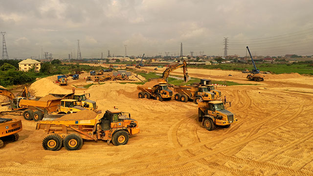 Stockpile Area at CH 29+700 – Loading of sand onto JBN equipment for filling of road embankment on Onitsha side